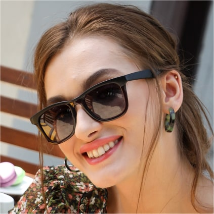 Young smiling woman with sunglasses